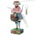 7-Inch Easter Cat Wearing an Easter Bonnet Holding a Basket of Easter Eggs Figurine