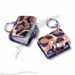 "Animal print notepad keychain, snaps shut, approximately 100 sheets, 2"" T"