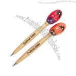 Assorted colored maraca tops on wooden pens.