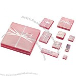 Cardboard Gift Box in Pink Color, Section of Ribbon