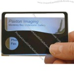 Credit-card size magnifier with light.