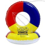 Heavy vinyl inflatable swim ring, multicolor on one side, white on reverse.