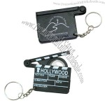 Hollywood clapboard design key holder with magnifier.