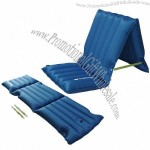 Inflatable air bed/chair with built-in pump