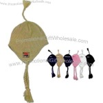 Knit hat with ear flaps and tassel. Removable tassels