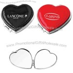 Leather heart compact mirror.
