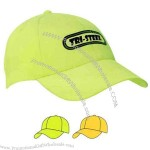 Luminescent safety cap with structured low profile and curved visor.