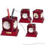 Rosewood pencil holder with clock, hygrometer, thermometer and photo frame.